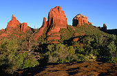 Along the Cibola Pass trail at sunrise the Cibola Mitten and spires are especially colorful.  Sedona Arizona USA.