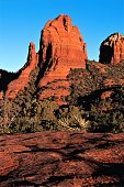 Cibola Pass Mitten rock formation at sunrise Sedona Arizona USA.  Crystal clear cold winter morning for great color.  Cibola Pass is a walking trail in Red Rock Wilderness Area.