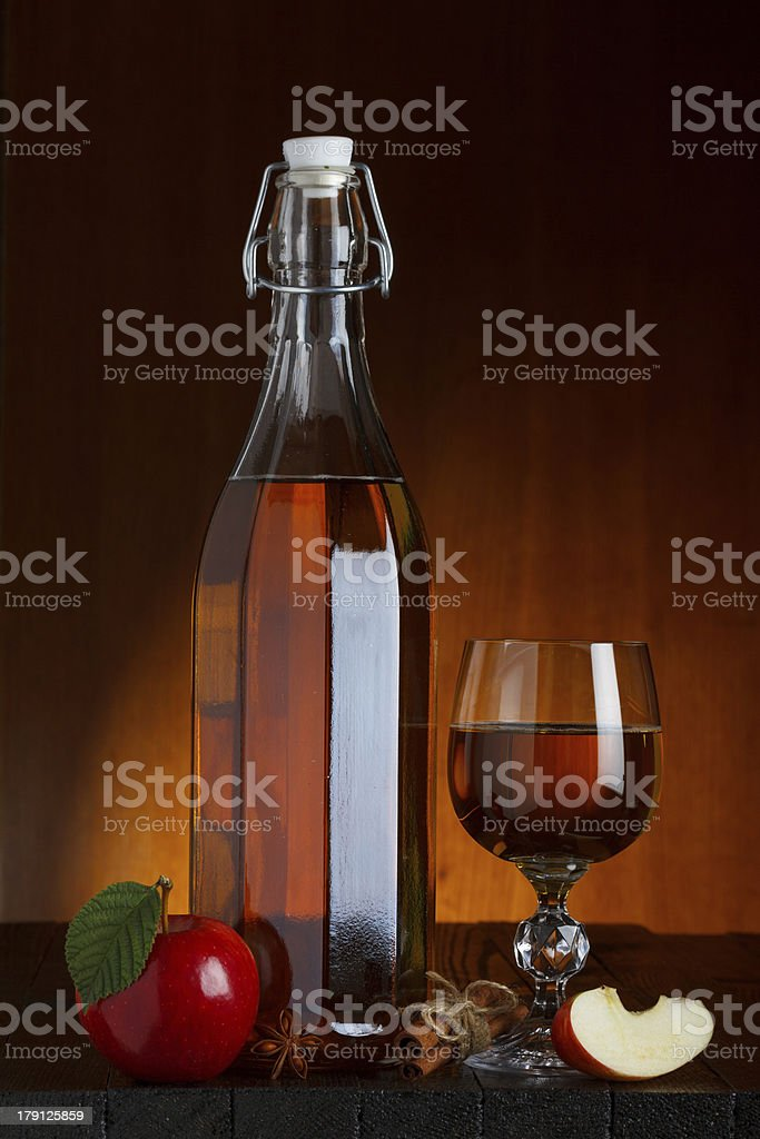 Cider bottle and glass royalty-free stock photo