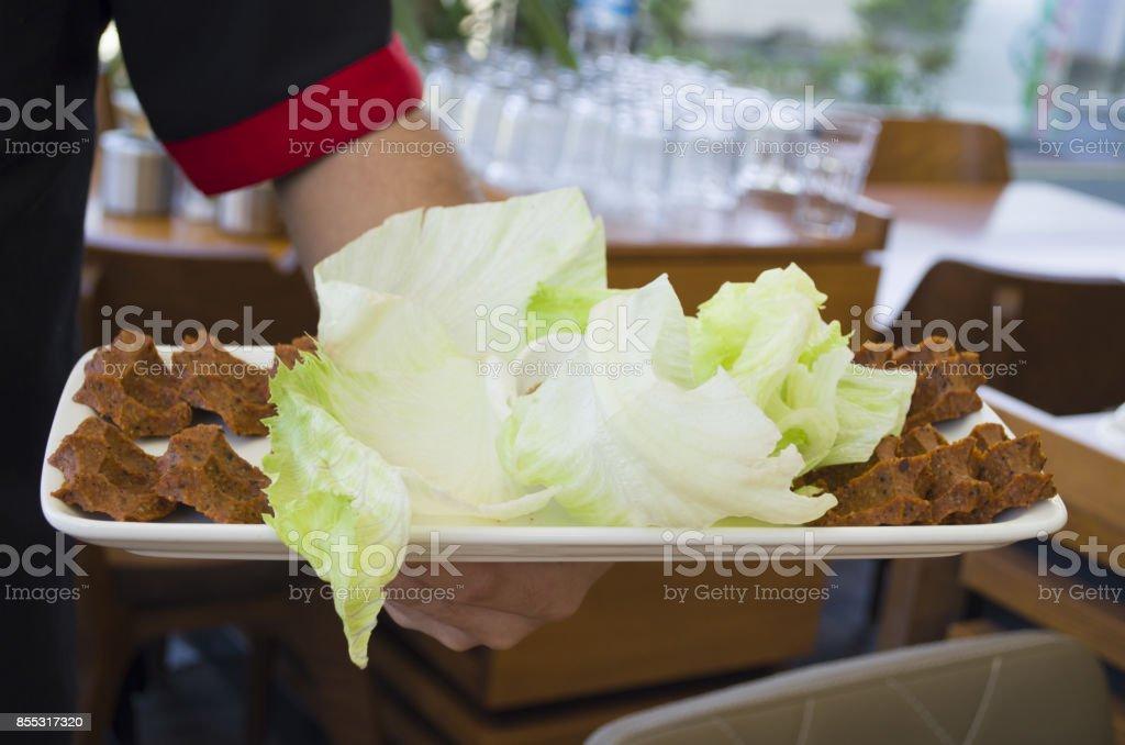 Cig kofte serving stock photo