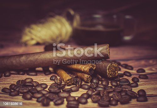 istock cigar and coffee 1061938616