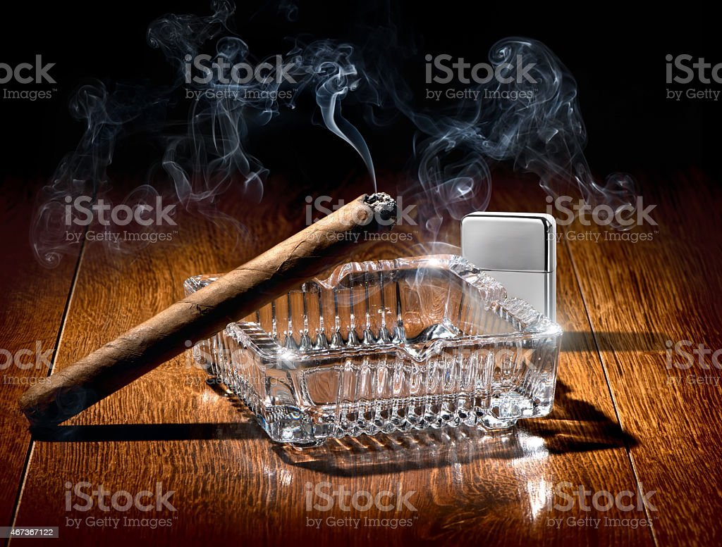 Cigar and lighter stock photo