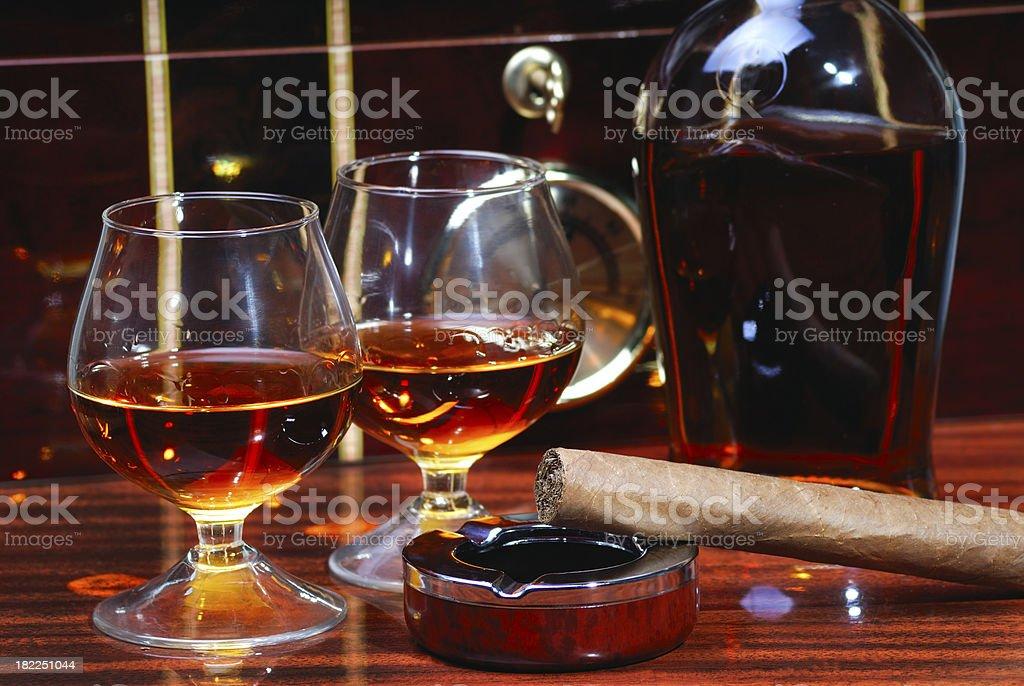 Cigar, Ashtray, Cognac and Humidor as Background stock photo