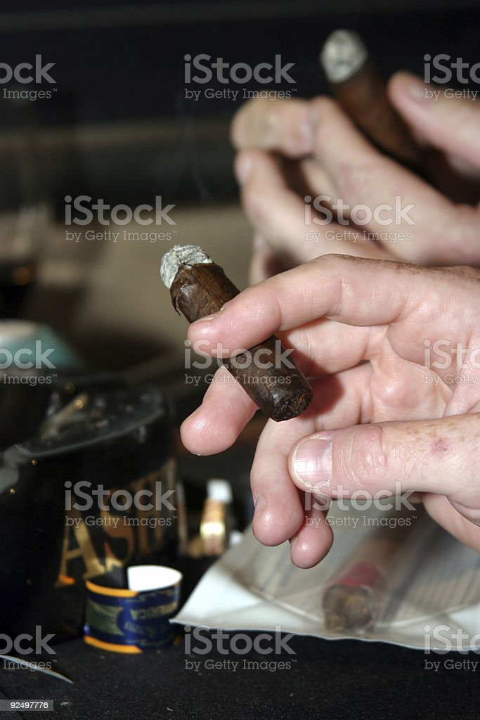 Cigar in hand royalty-free stock photo