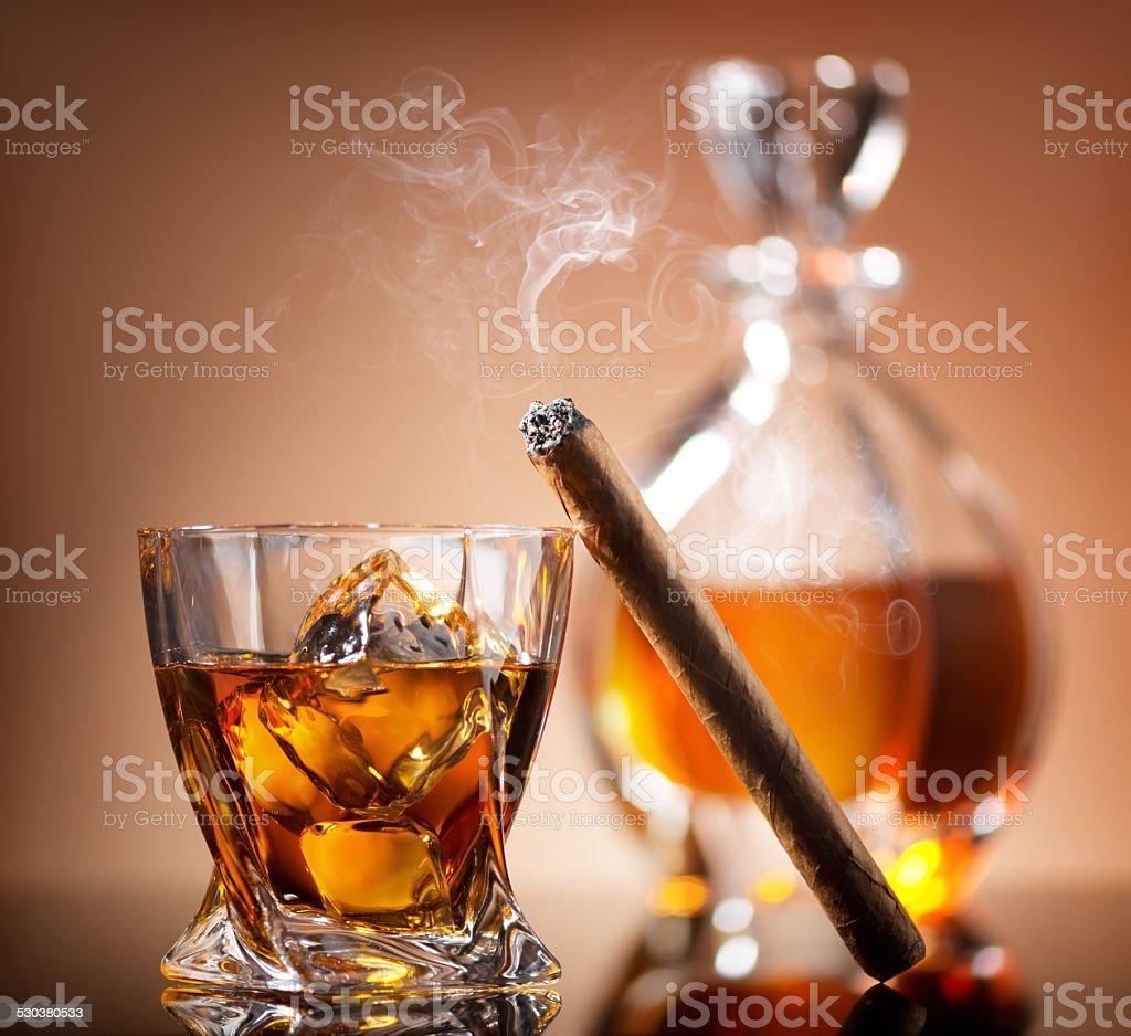 Cigar on glass stock photo