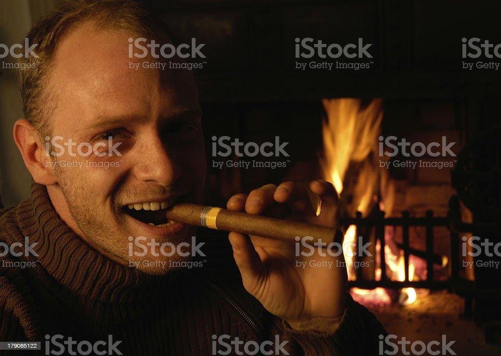 cigar smoker (chimney behind) royalty-free stock photo