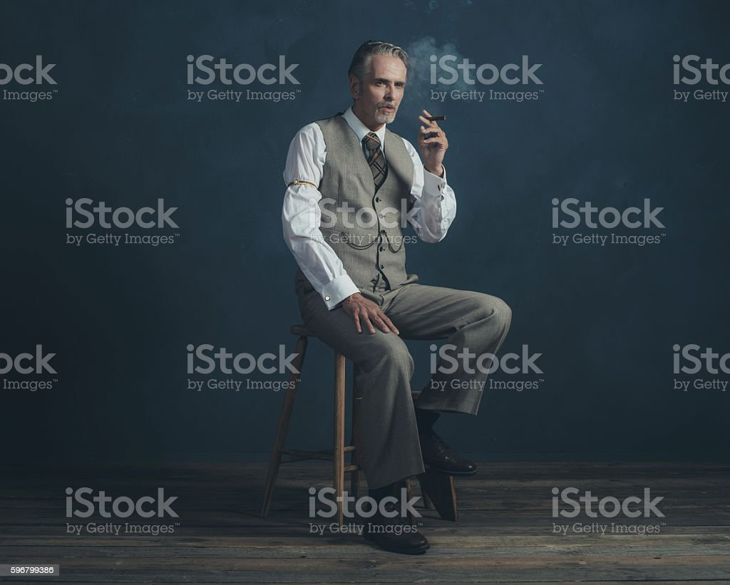 Surprising Cigar Smoking Retro 1920S Man Sitting On Wooden Stool Stock Ocoug Best Dining Table And Chair Ideas Images Ocougorg