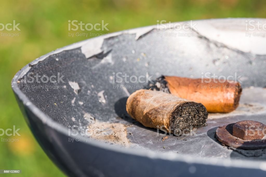 Cigar stubs in an ashtray stock photo