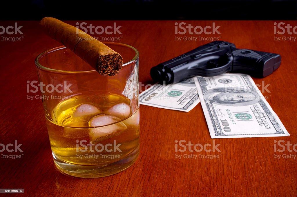 Cigar, Whiskey, Dollars and handgun royalty-free stock photo