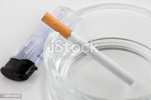 Burning cigarette and ashtray close up