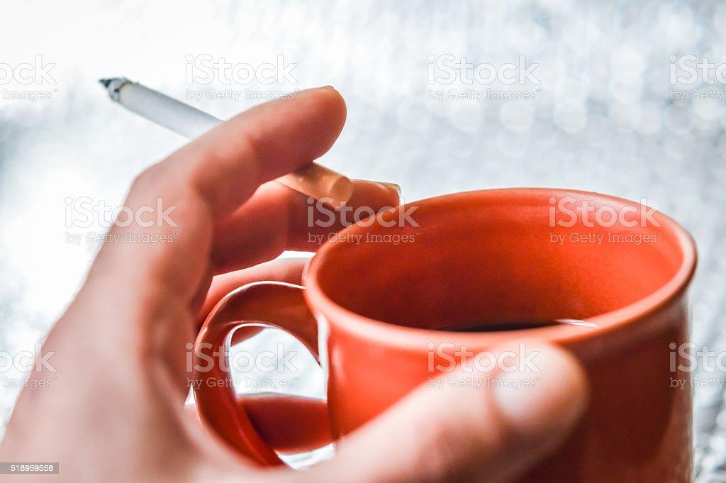 cigarette and coffee stock photo
