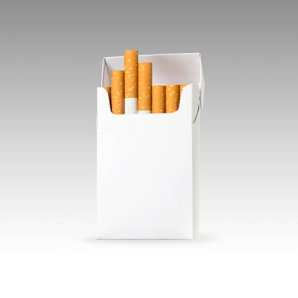 cigarette and pack of cigarettes with clip path. photo image - paquete cigarrillos fotografías e imágenes de stock