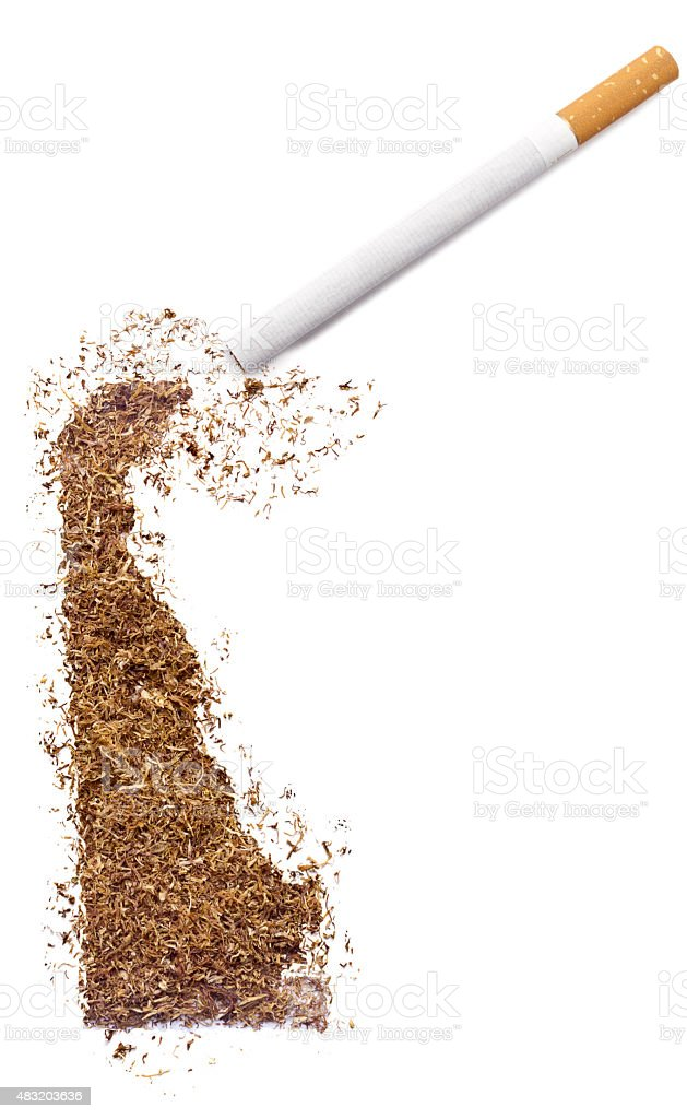 Cigarette and tobacco shaped as Delaware (series) stock photo