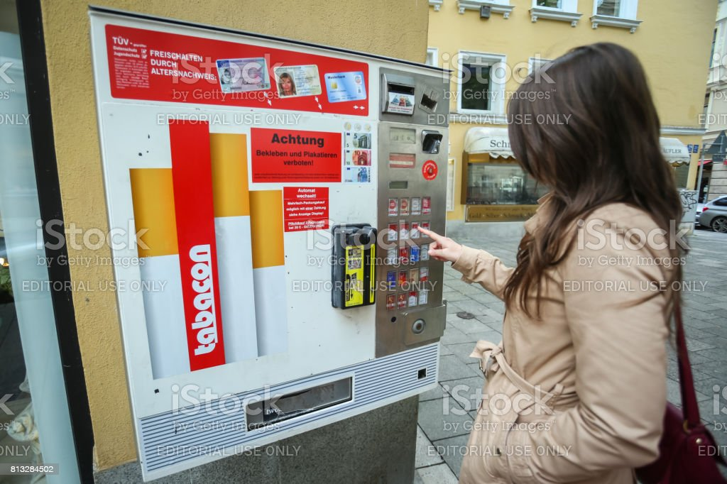 Cigarette automat in street stock photo