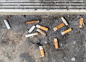 istock Cigarette butt a lots disgusting dirty discarded 1022254912