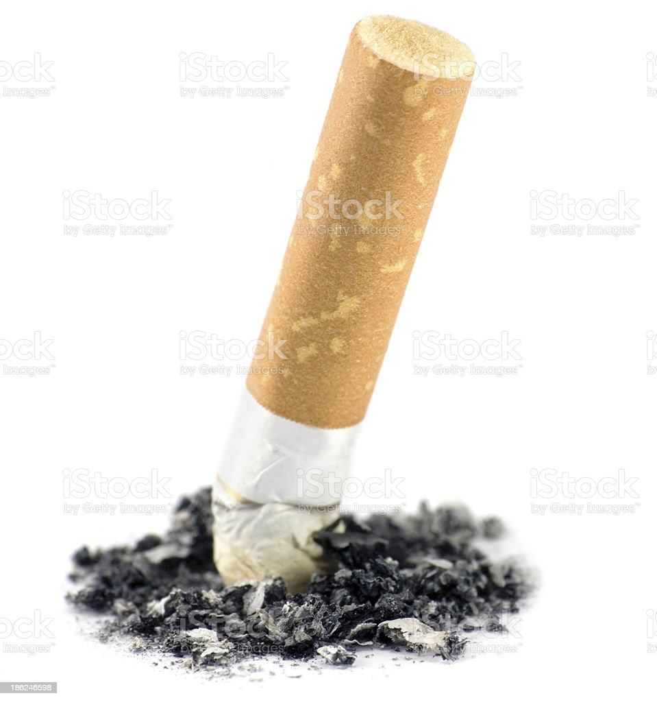 Cigarette butt and ash macro closeup, isolated studio shot stock photo