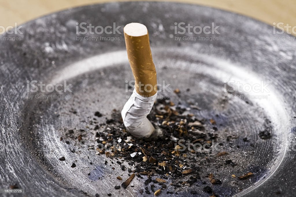Cigarette butt in ashtray stock photo