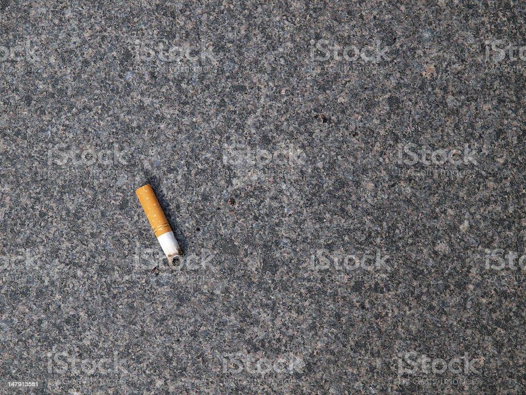Cigarette Butt on granite stock photo