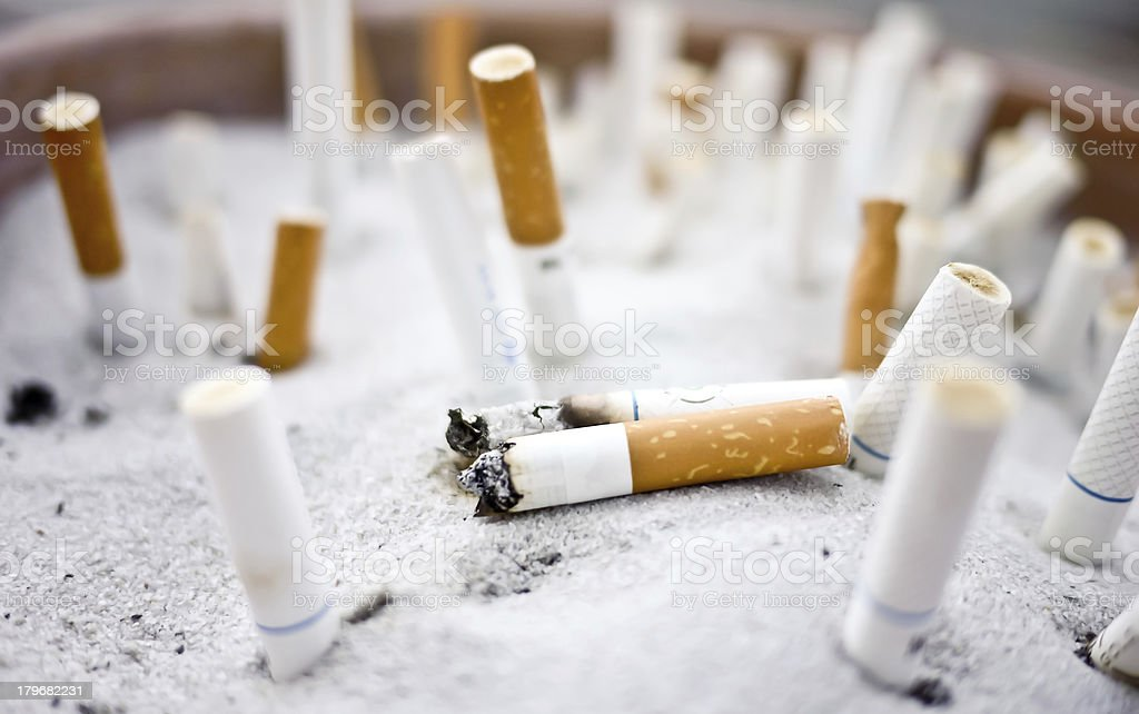 cigarette butts in ashtray royalty-free stock photo
