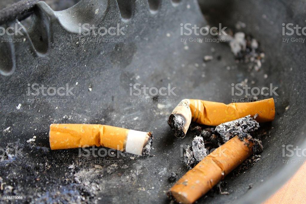 Cigarette Butts in Ashtray stock photo