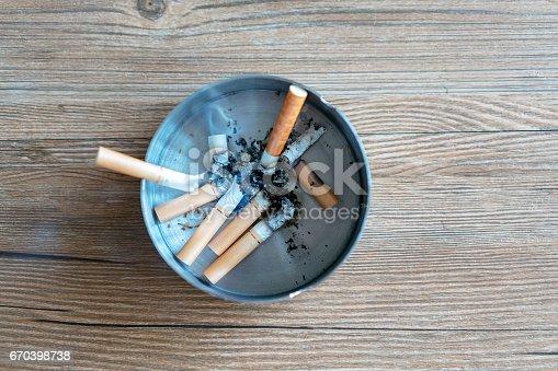 istock cigarette butts in ashtray 670398738