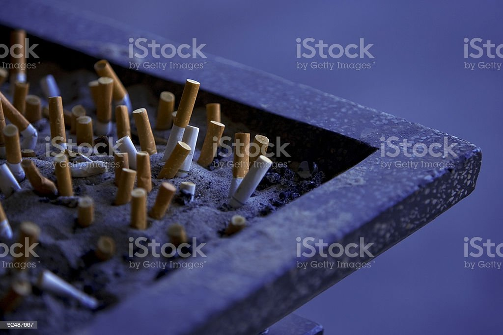 Cigarette butts in outdoor ashtray royalty-free stock photo