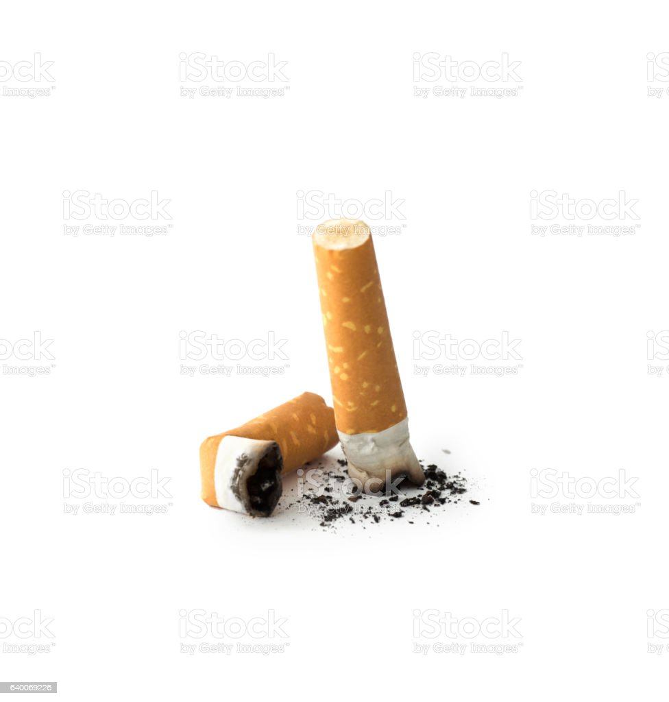 Cigarette butts with ash stock photo