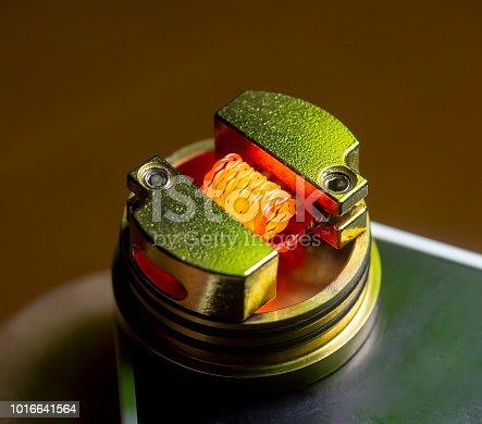 1137088939 istock photo E Cigarette Coils Dry Burn,Burning Nichrome Coil, nichrome wire vape on a dripper gold, vaporizer e-cig, e-cigarettes 1016641564