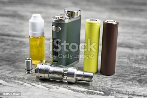 istock E - cigarette for vaping , technical devices.The liquid in the bottle 1035305678