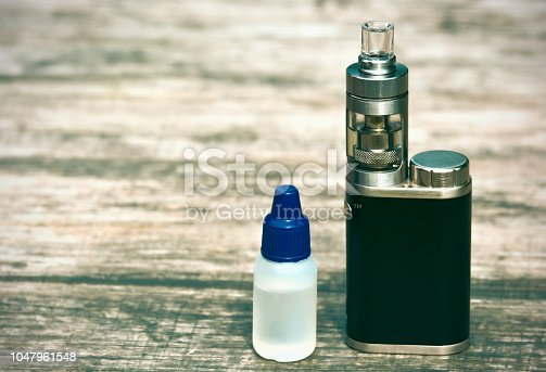 1047961600 istock photo E - cigarette for vaping , technical devices.The liquid in the bottle 1047961548
