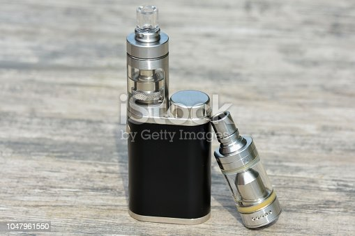 1047961600 istock photo E - cigarette for vaping , technical devices.The liquid in the bottle 1047961550
