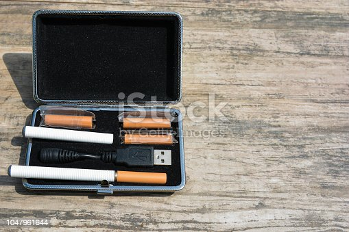 1047961600 istock photo E - cigarette for vaping , technical devices.The liquid in the bottle 1047961644