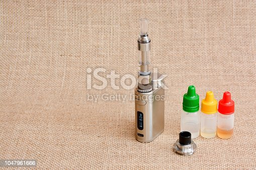 1047961600 istock photo E - cigarette for vaping , technical devices.The liquid in the bottle 1047961666