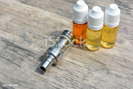 1047961600 istock photo E - cigarette for vaping , technical devices.The liquid in the bottle 1047961668