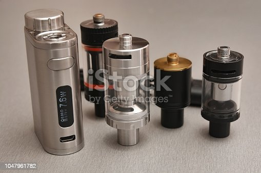 1047961600 istock photo E - cigarette for vaping , technical devices.The liquid in the bottle 1047961782