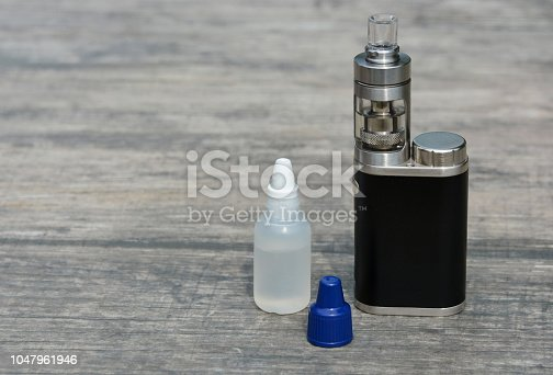 1047961600 istock photo E - cigarette for vaping , technical devices.The liquid in the bottle 1047961946