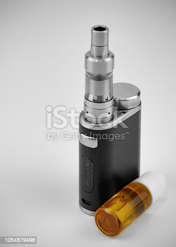 istock E - cigarette for vaping , technical devices.The liquid in the bottle 1054879498