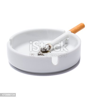 Cigarette in an ashtray on a white background