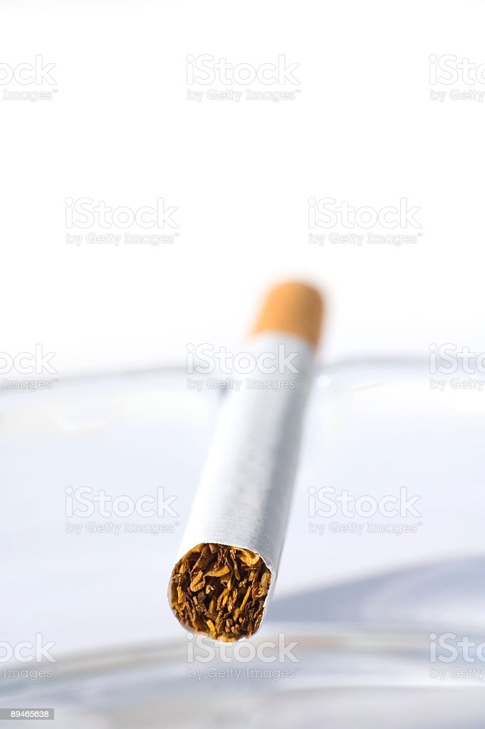 Cigarette in ash tray royalty-free stock photo