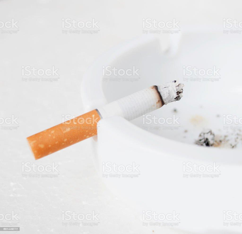 Cigarette in ashtray stock photo