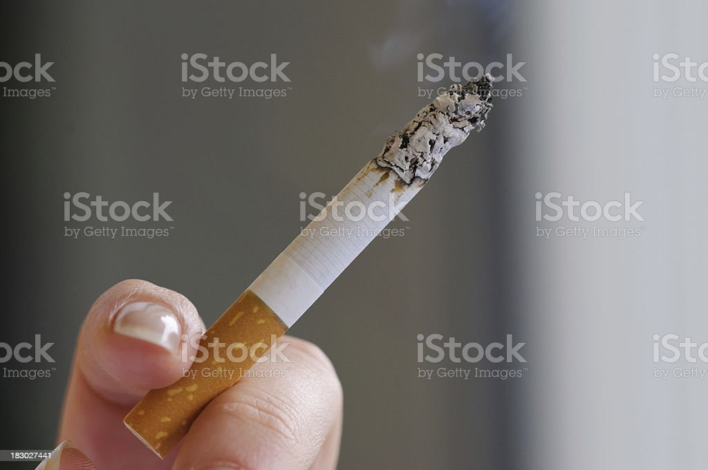 Cigarette in hand royalty-free stock photo
