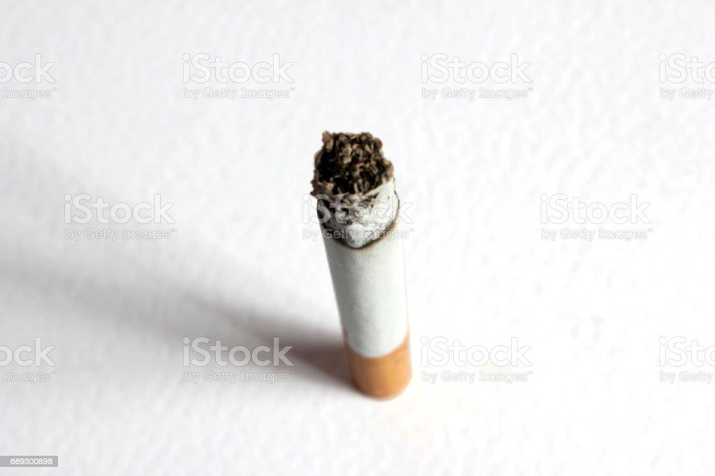 Cigarette on white ground stock photo