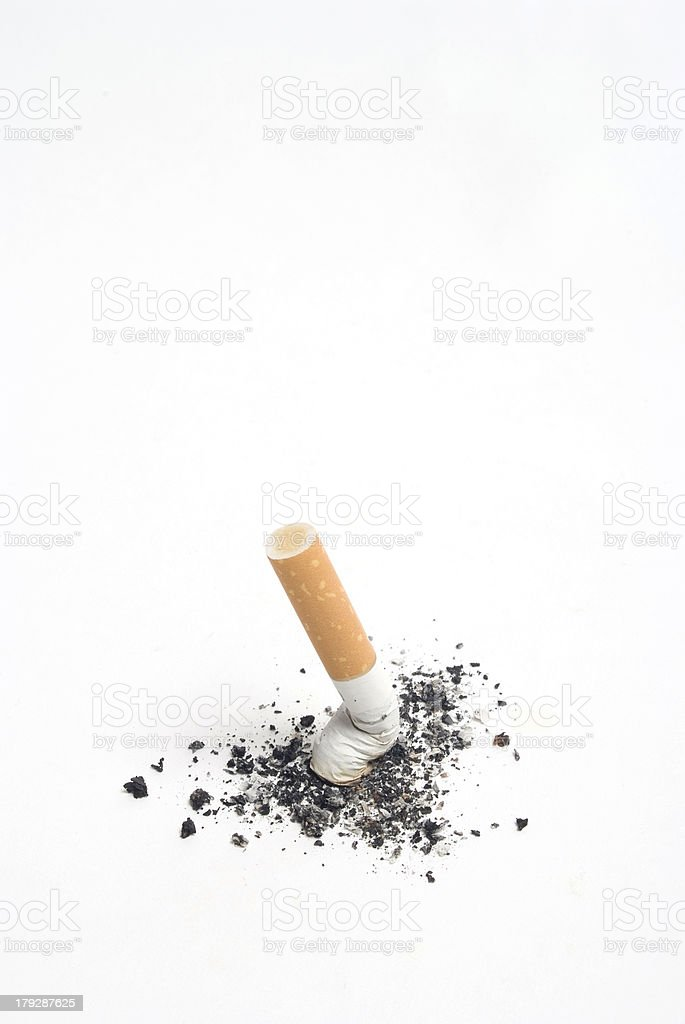 cigarette on white, stubbed out. stock photo
