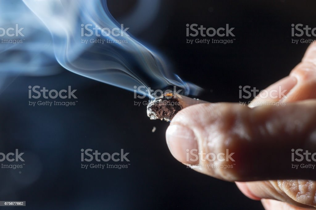 Cigarette smokes in hand royalty-free stock photo