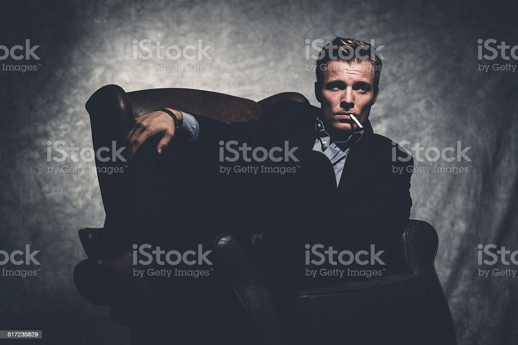 Cigarette smoking retro fifties cool business fashion man wearing...