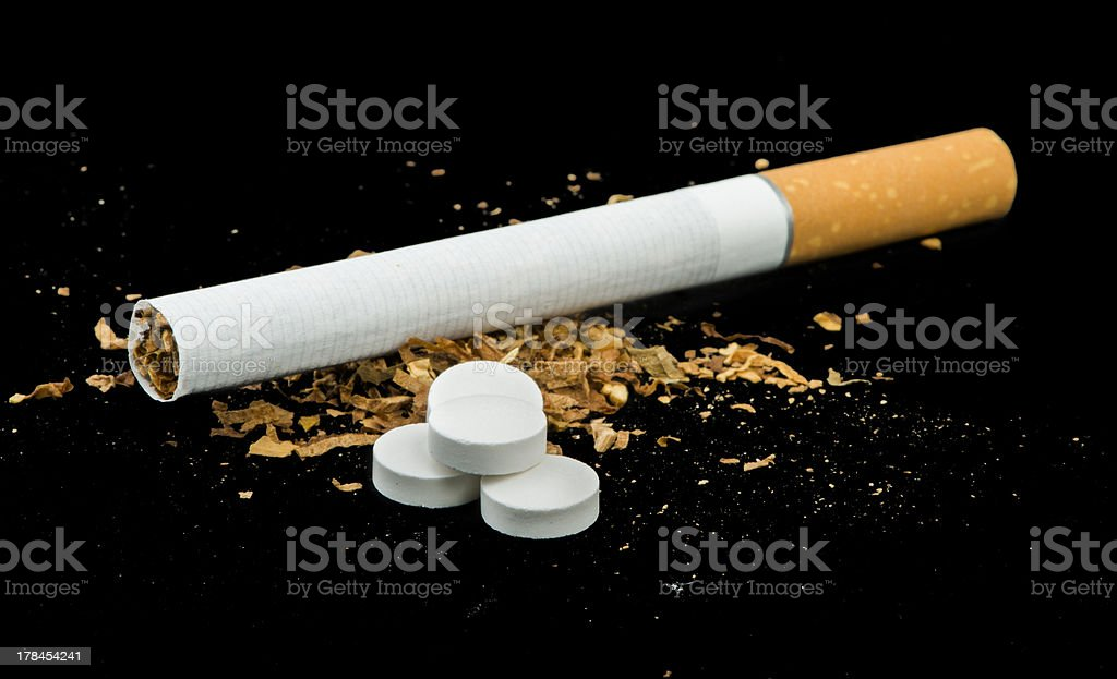 Cigarette, tobacco and pills royalty-free stock photo