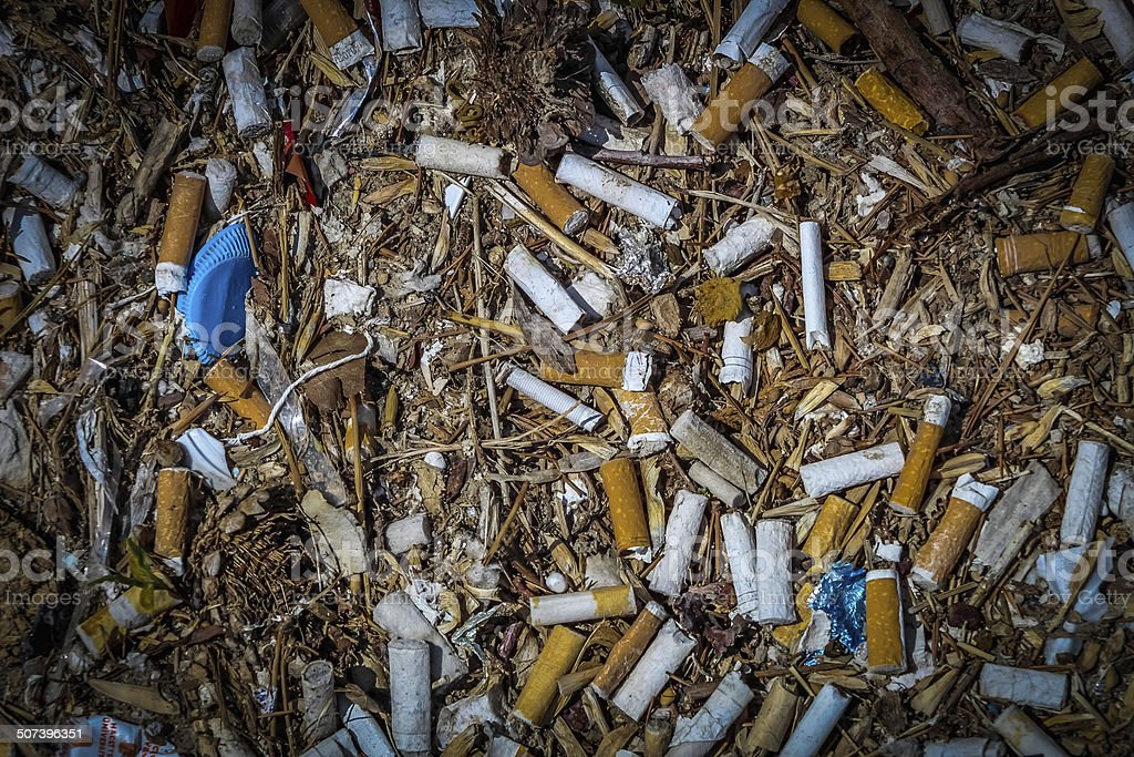 Cigarette Trashes on the Filty Ground stock photo