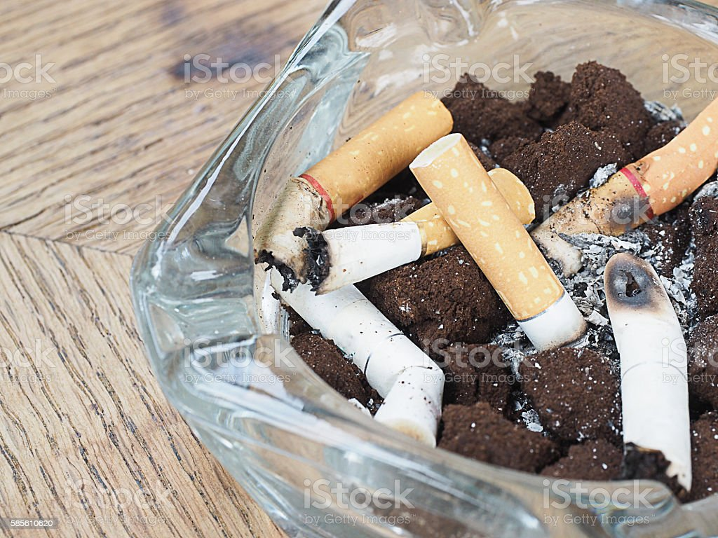 cigarette with an ashtray on the wood table stock photo