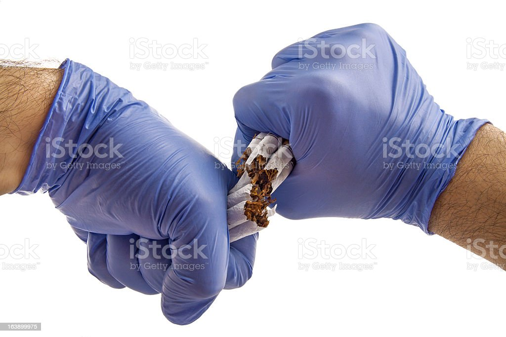 Cigarette with gloved hands stock photo