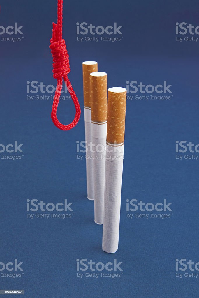 Cigarettes and hanging rope stock photo
